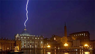Lightning strikes the very apex of St. Peter's Basilica in the Vatican.